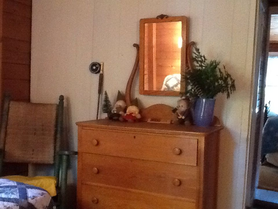 Bedroom #3.  Old fly rod. The gnomes arrived over 30 years ago and never left.  They love the lake too.