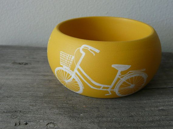 OMG!! so cute. Yellow bicycle bracelet available on etsy from Aramar for $18. Must have this!