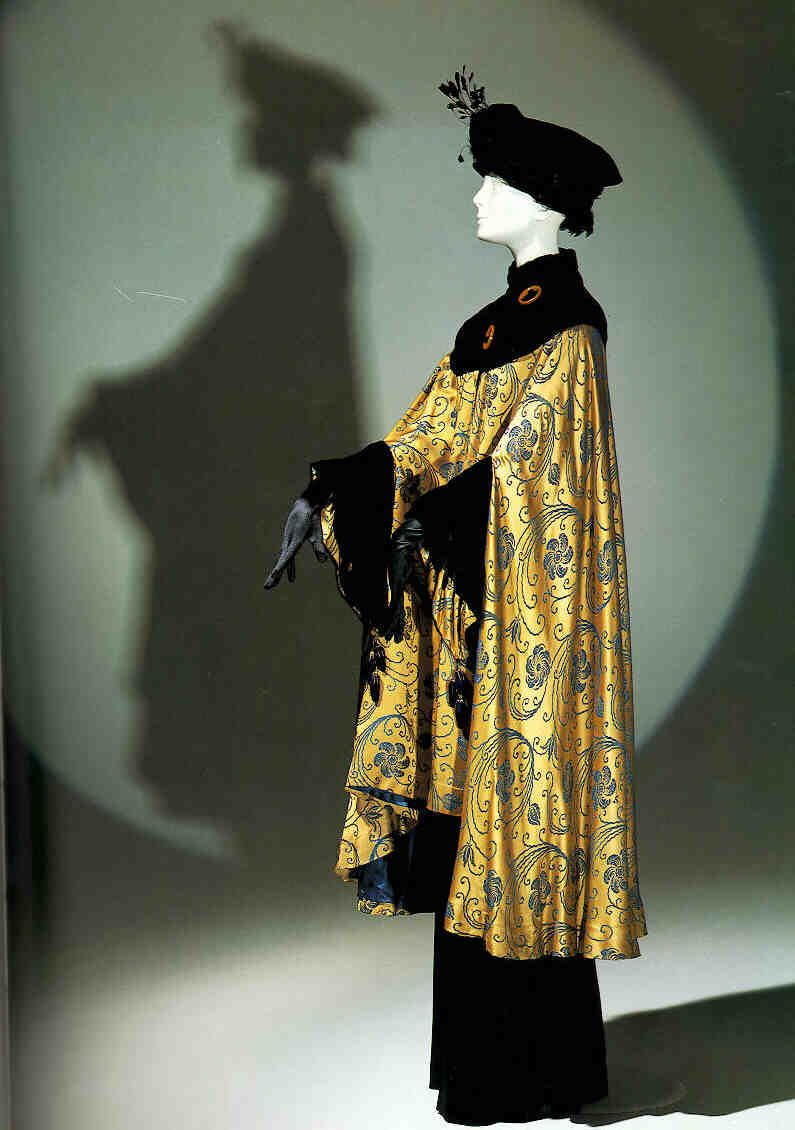 Opera coat, France, 1910s. Attributed to Paul Poiret. Silk damask and silk panne velvet cut on a bias. The swirling pattern of the damask was inspired by the meandering botanical motifs of Islamic art and influenced by the Arts and Crafts and Art Moderne Movements.