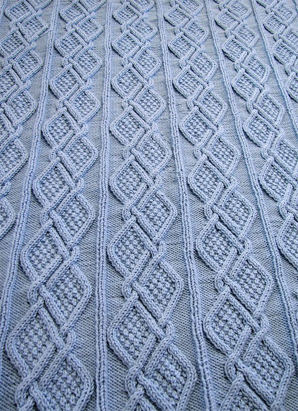 Free Knitting Pattern for Moss Diamonds Cabled Baby Blanket - Designed by Knitting Unlimited. Finished size: 40 x 44 . Pictured project by SibeStride. #babyblanket