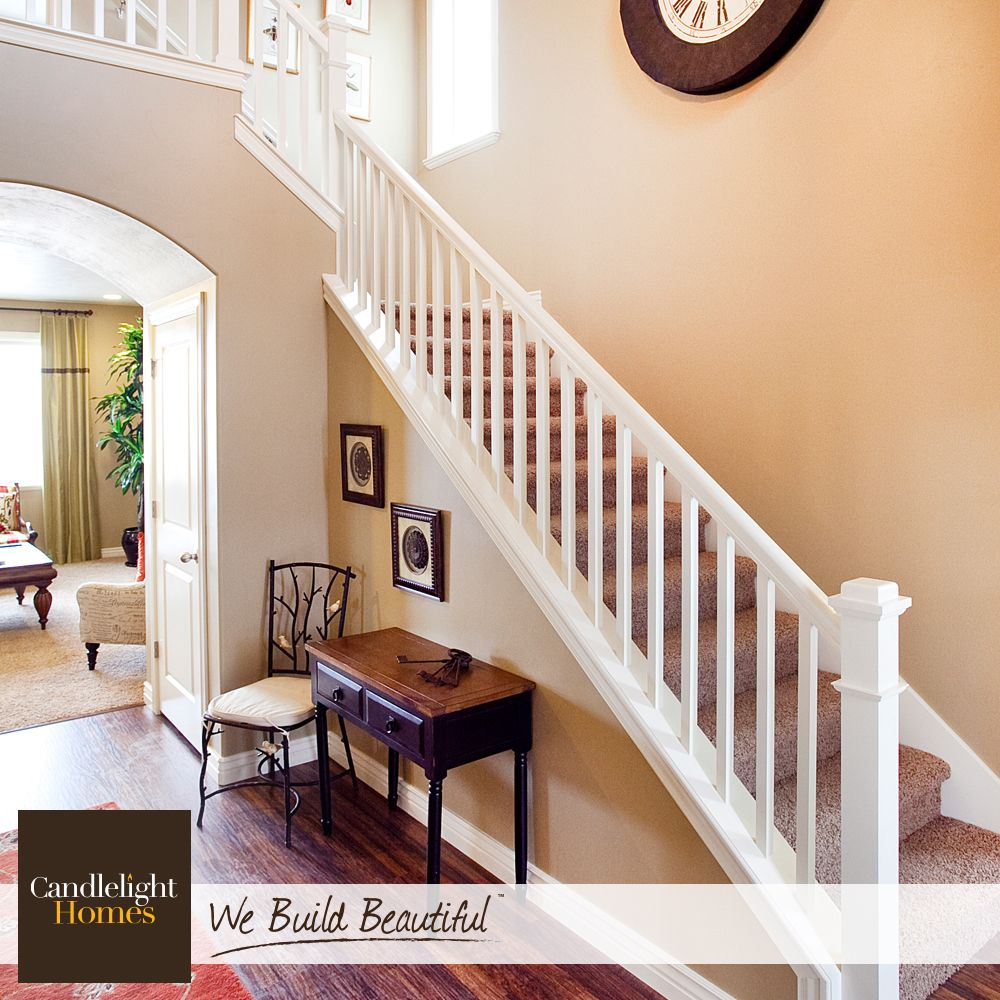 Step up your stair game with simple white railing and