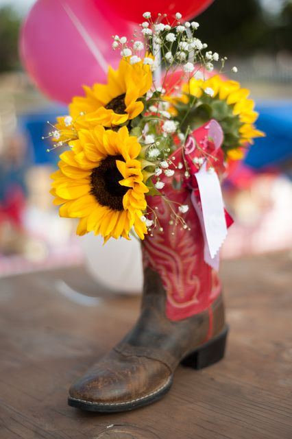 6a704d58ff6 Cowboy boots and sunflowers centerpiece at a Cowgirl Birthday Party ...