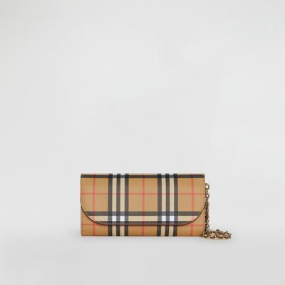 2f42192388e3 A compact wallet in Vintage check and calf leather. Wear as a small-scale