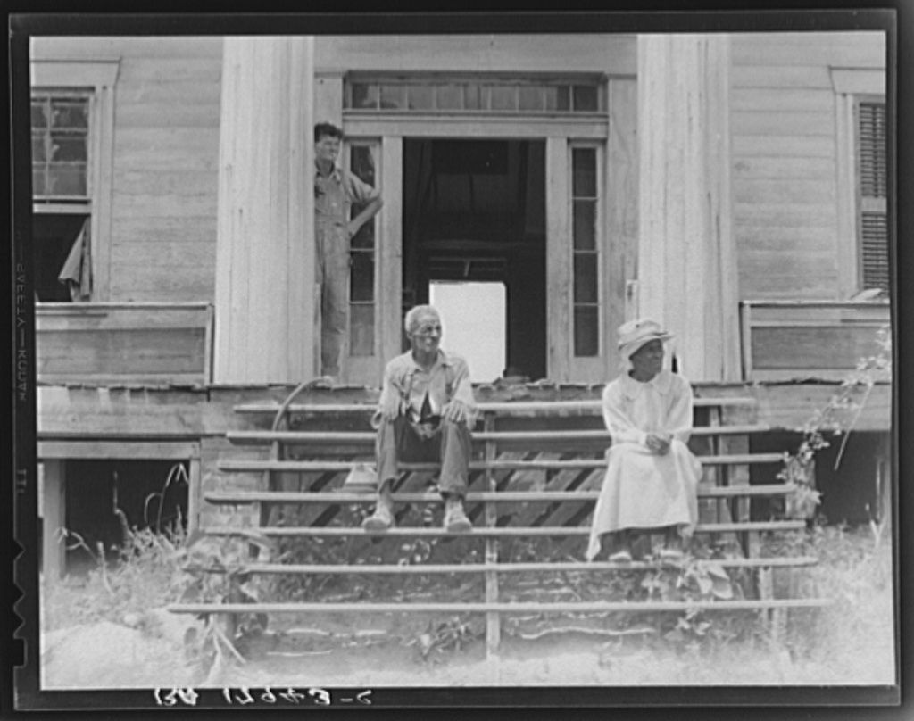 Ex Slave And Wife On Steps Of Plantation House Now In