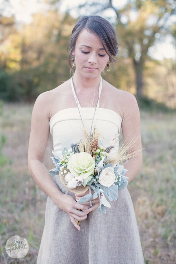 fall bridesmaid with bouquet and field