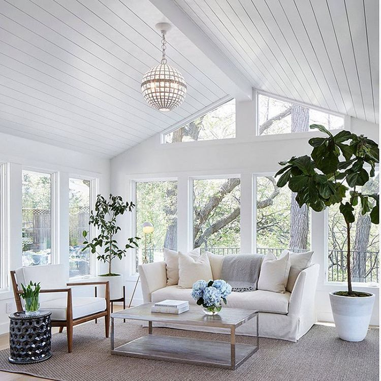 This Family Room/sunroom Is Pure Serenity With Its White