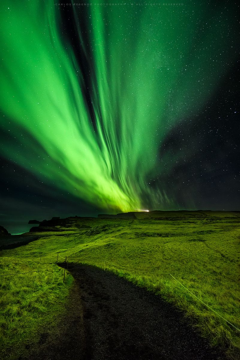 """Over Dyrholaey - Vik - Iceland This time with the camera turned to the right having the Dyrhólaey Lighthouse in backgroud. A night full of dancing lights ! Visit My <a href=""""http://www.cresendephotography.com/"""">Personal Site</a> or follow me in <a href=""""https://www.facebook.com/cresendephotography"""">Facebook</a> 