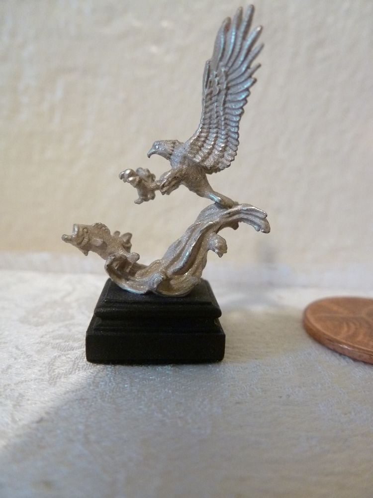Daniel Kronberg, IGMA fellow - silver sculpture of an eagle swooping down to catch a fish in mid-flight; sold on ebay for $125
