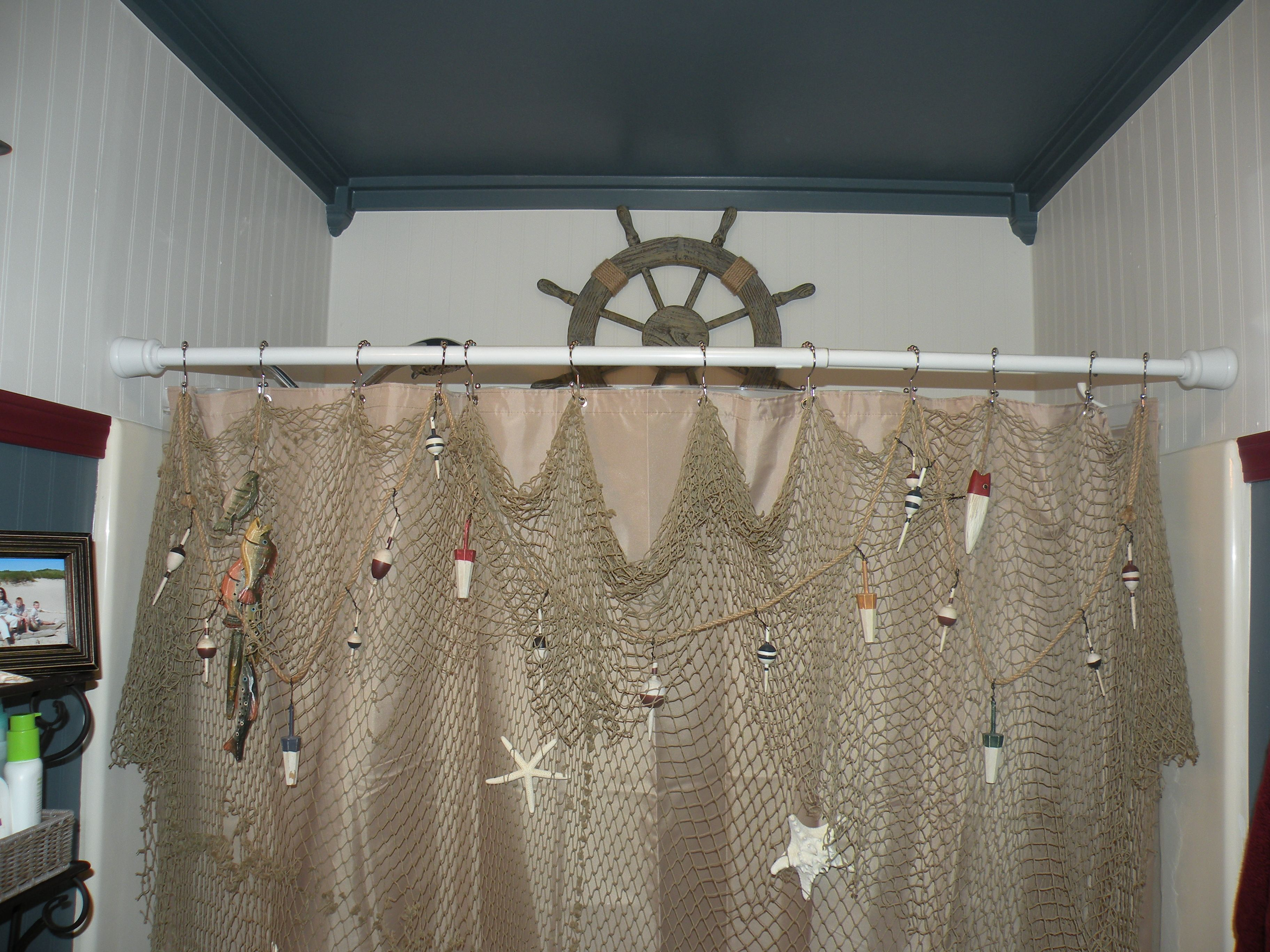 I hung a decorative fishing net with wooden fish and real starfish ...