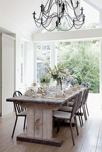 The Long Arm Chandeliers Add An Airy Feeling To A