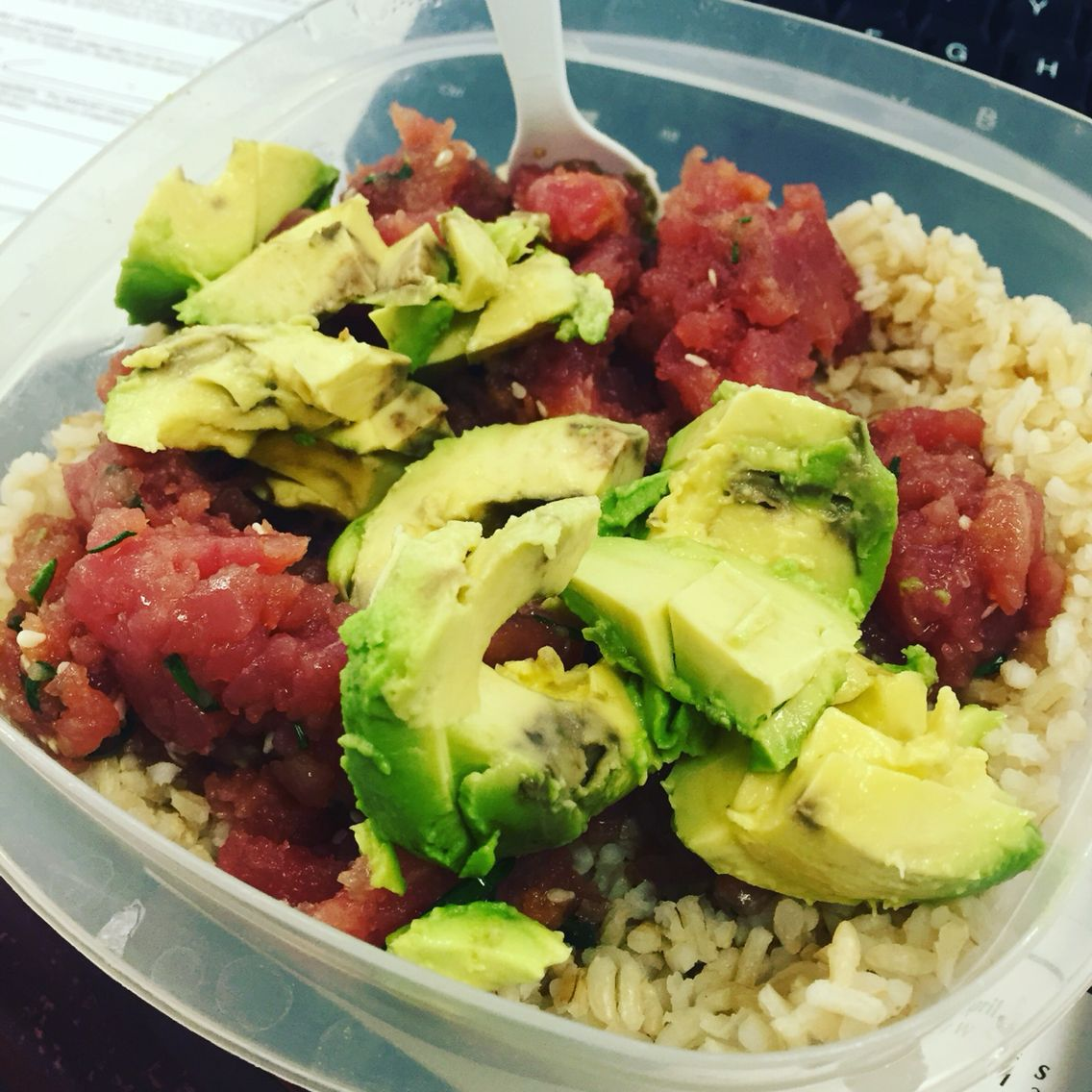 Homemade tuna tar tar with avocado over brown  rice . Great lunch and super good