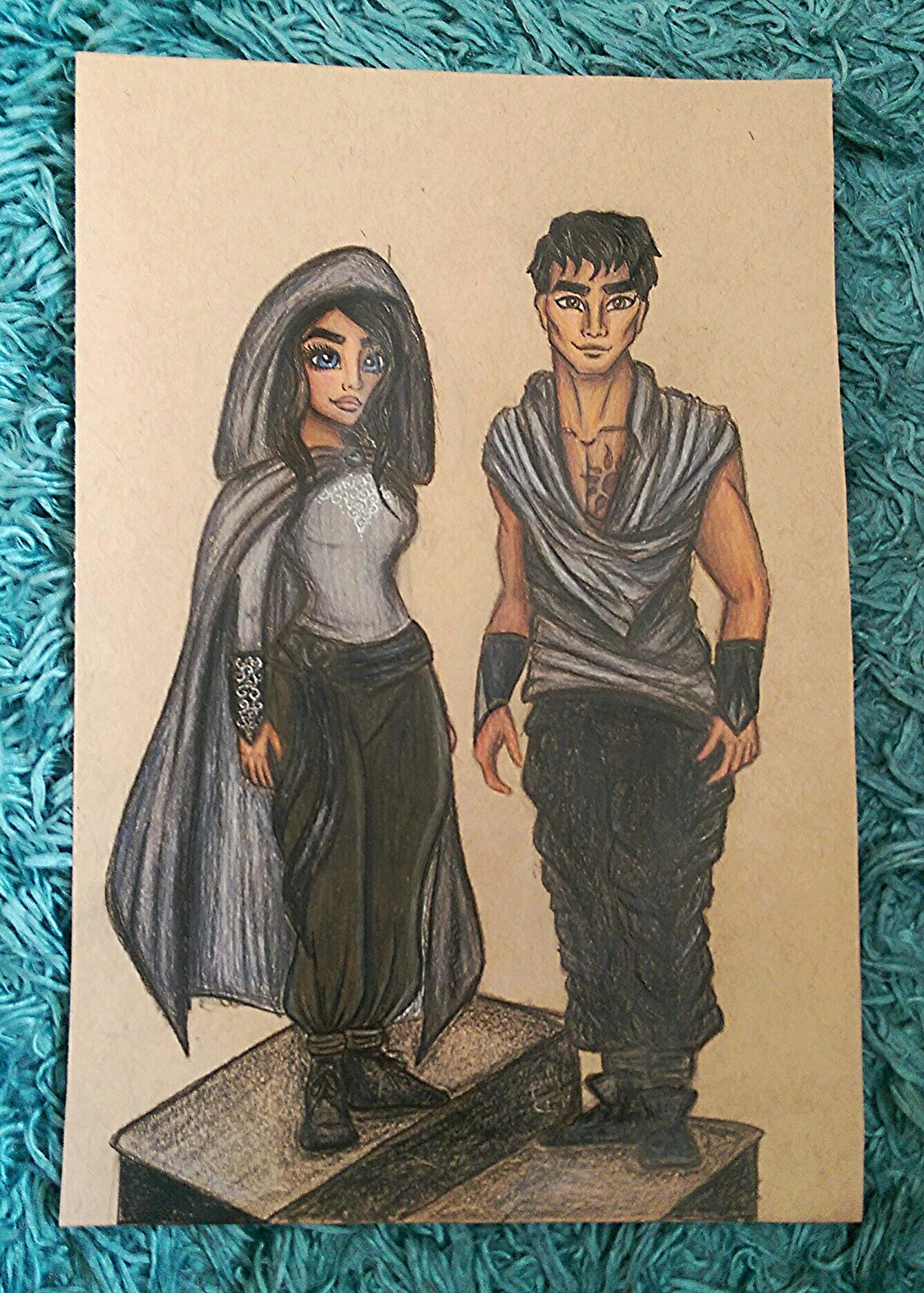 Amani (blue eyed bandit) and Jin drawing from Rebel of the sands (by Alwyn Hamilton) Using Faber Castell polychromos pencils.