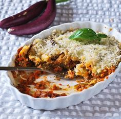 Eggplant Parmesan For One. The eggplant is NOT fried. Eggplant is dipped in egg, coated in breadcrumbs, and baked in the casserole dish with the sauce and cheese.