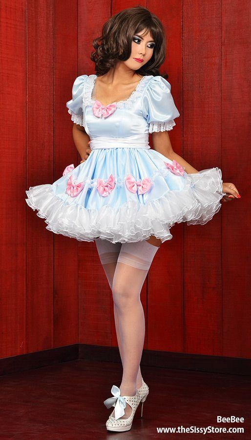 Sissy tgirl maid in a pink petticoat fucks a wine bottle