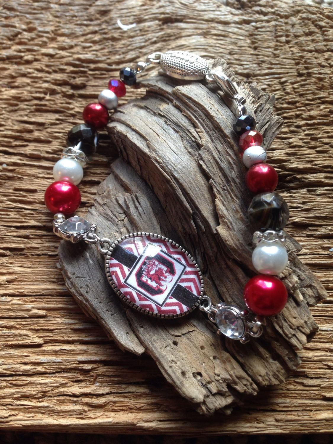 A personal favorite from my Etsy shop https://www.etsy.com/listing/483138716/usc-gamecocks-upcycled-bracelet-carolina