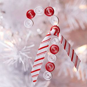 """Candy Cane Ornament    This cool candy cane ornament is quick and easy to make. Cut 1/8""""-wide red and white paper quilling strips to 6"""" long. Shape quills into spirals by wrapping the paper around a toothpick, then glue the spirals together edge to edge, alternating the red and white. Knot a length of ribbon, trim, and glue it on the candy cane as an accent. Attach the hanging thread."""