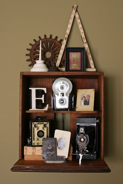 Vintage camera display showcased in a repurposed oak cabinet drawer shelf
