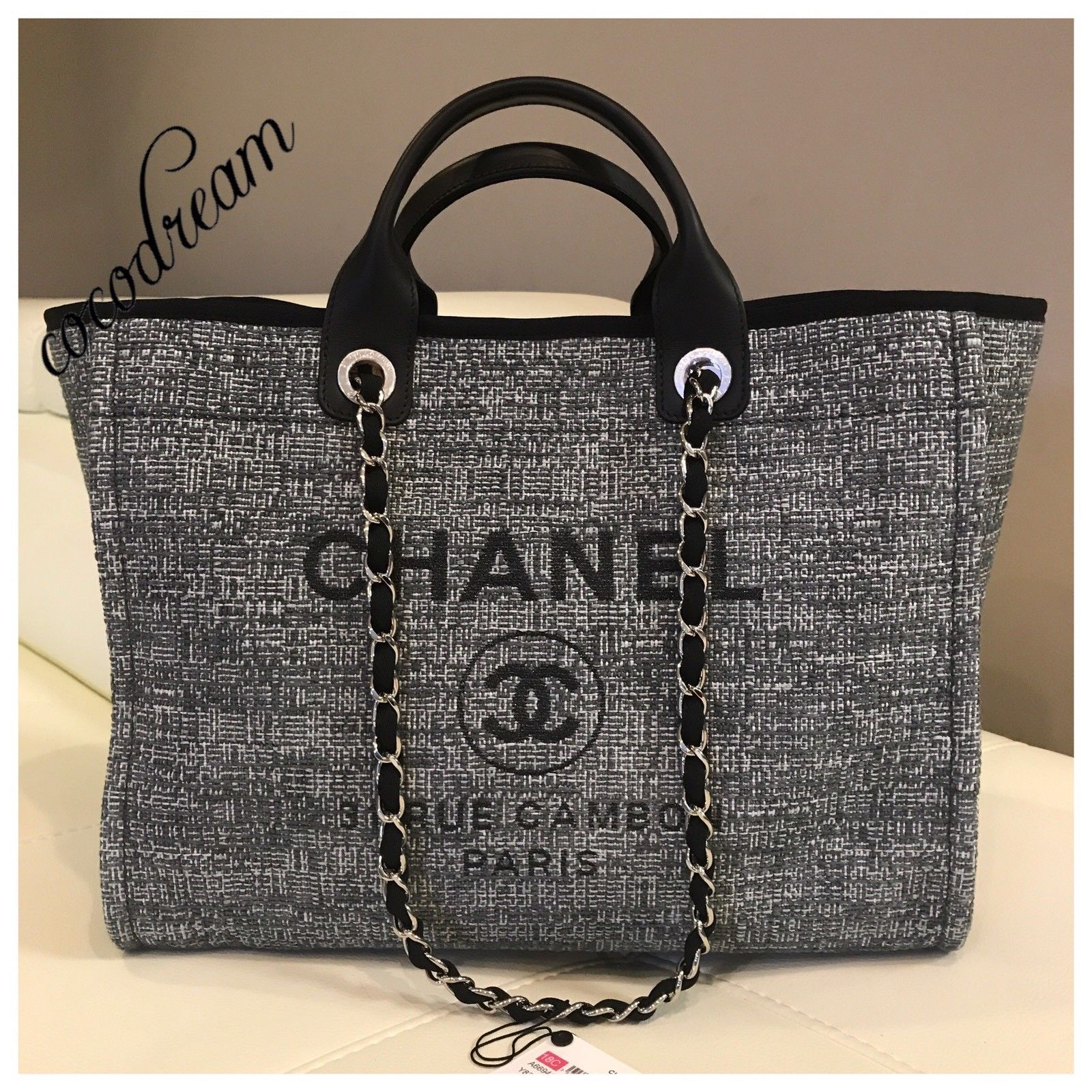 7ad665a672a4 This gorgeous bag is a classic deauville tote bag in Gary charcoal color  with black timming and black Metallic CHANEL AND CC ...