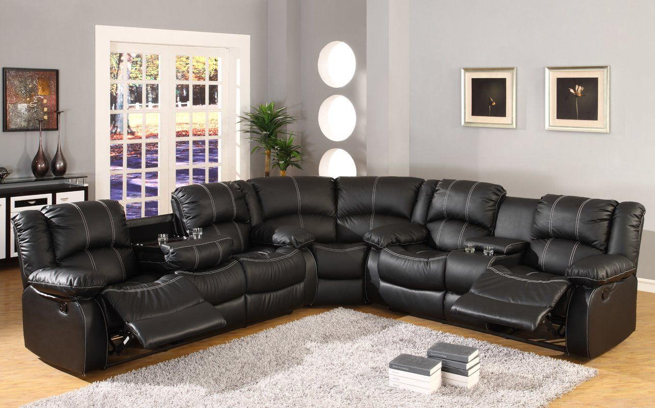 The Reclining Curved Sectional Has Hidden Storage And Cup Holder