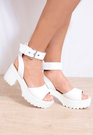 2d8282ce8 Koi Couture are the brand of these shoes and we sell at Shoe Closet. The  come in white pu leather with strappy sandals and cleated platforms