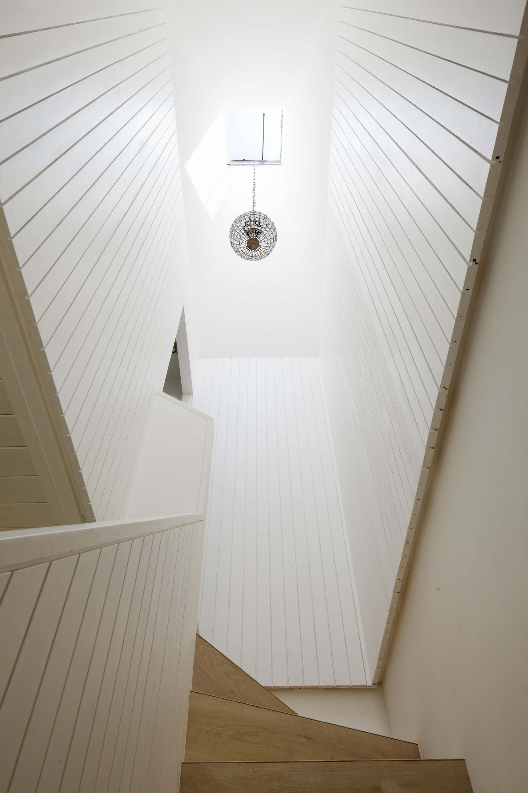 Rooflight over beautifully detailed timber staircase. Dorset Road, Alexandra Palace - Sam Tisdall Architects