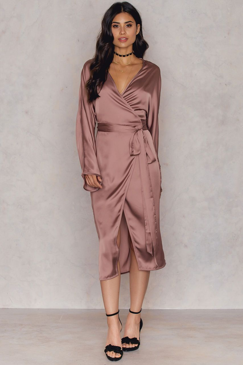 5aba6f321648 The Kimono Wrapped Dress by Hannalicious for NA-KD comes in pink terracotta  and features a shiny lightweight fabric with long sleeves, a belted kimono  ...