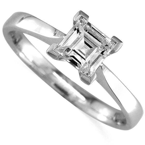 Carre Cut Diamond Solitaire. A square cut diamond, makes a beautiful, subtle alternative to the more popular Princess cut diamond. This Carre cut diamond solitaire ring, has box claws, to protect the diamond corners and a wedding ring fit, to allow a perfect flush fit with a wedding ring.