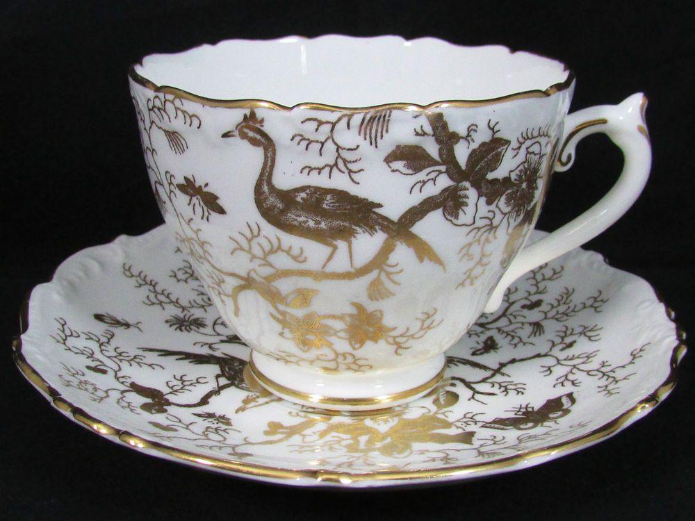 COALPORT WHITE AND GOLD GILT CAIRO BIRD TEA CUP AND SAUCER