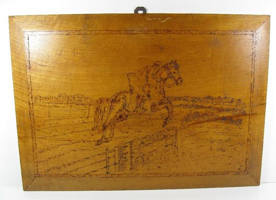 this is so cool!   vintage wall plaques showing horses jumping