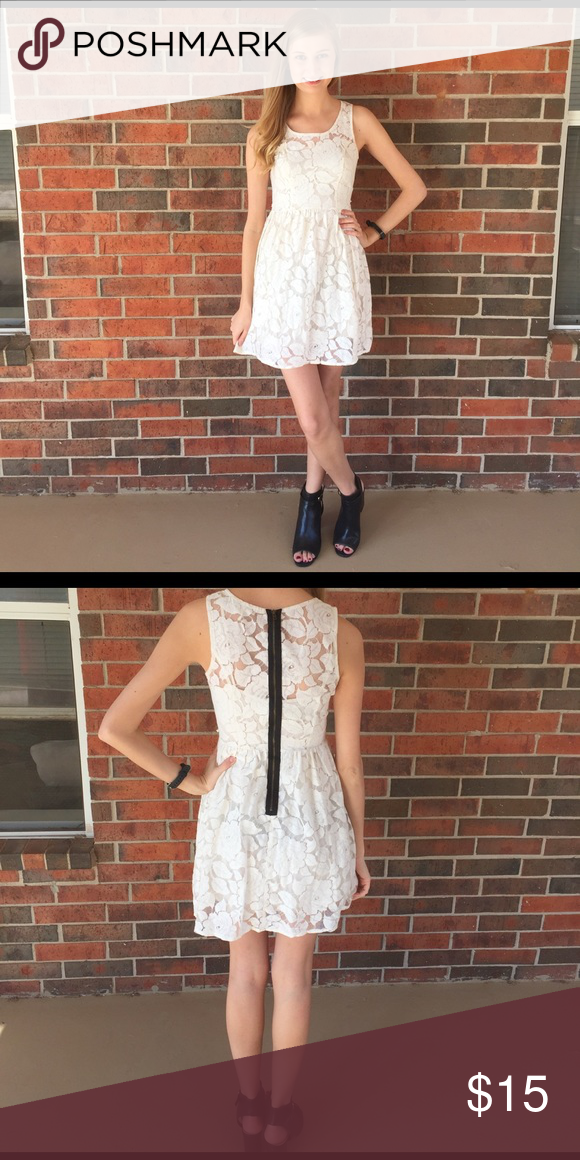 White lace dress White lace dress with black zipper accent! Used to have belt, but I didn't like it so cut the belt loops off. You could still pair with a belt if you wanted! Comes with a built in slip underneath dress. Dresses
