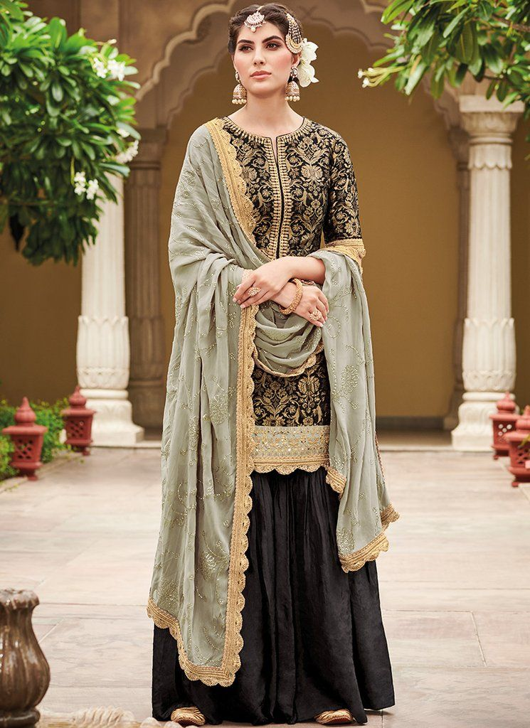 bffb5a3b60 Black and Light Grey Gharara Suit features a silk jacquard blouse with  santoon inner, cotton satin bottom and pure bemerg georgette embroidered  dupatta.