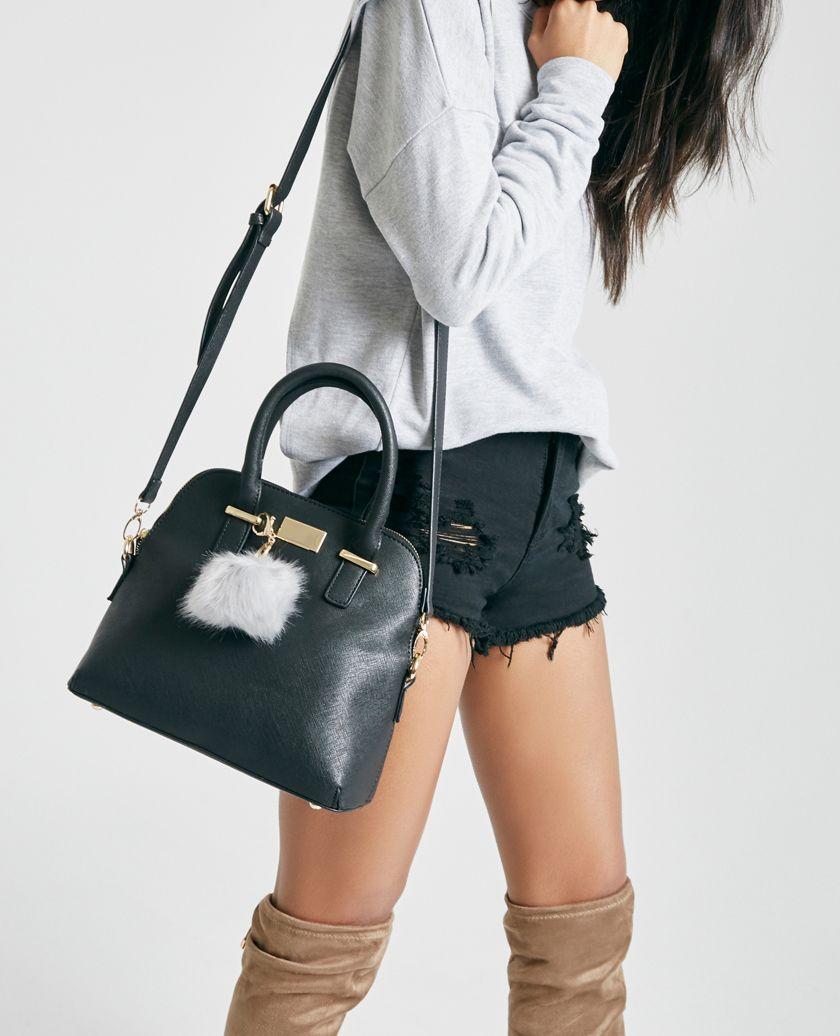 PEDIDOS SOLO POR #ENCARGO  #CatálogoSeptiembre2016 Código: WS-23 Mini Tote Bag With Pom Pom Color: Black  Precio: ₡28.900  Whatsapp ☎8963-3317, escribir al inbox o maya.boutique@hotmail.com  Envíos a todo el país. #MayaBoutiqueCR