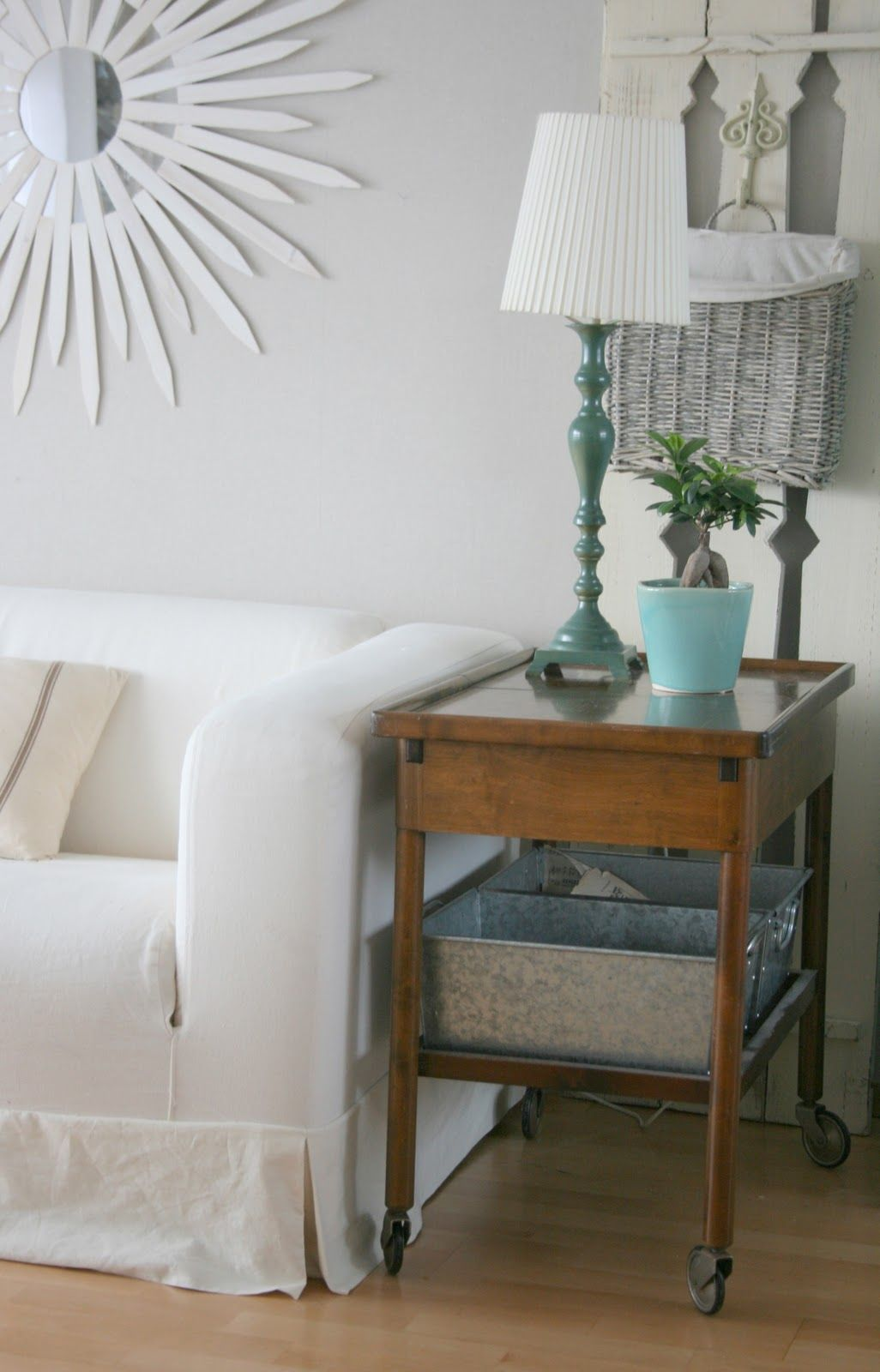 LOVE castors! galvanized buckets on table's shelf. love white couch!