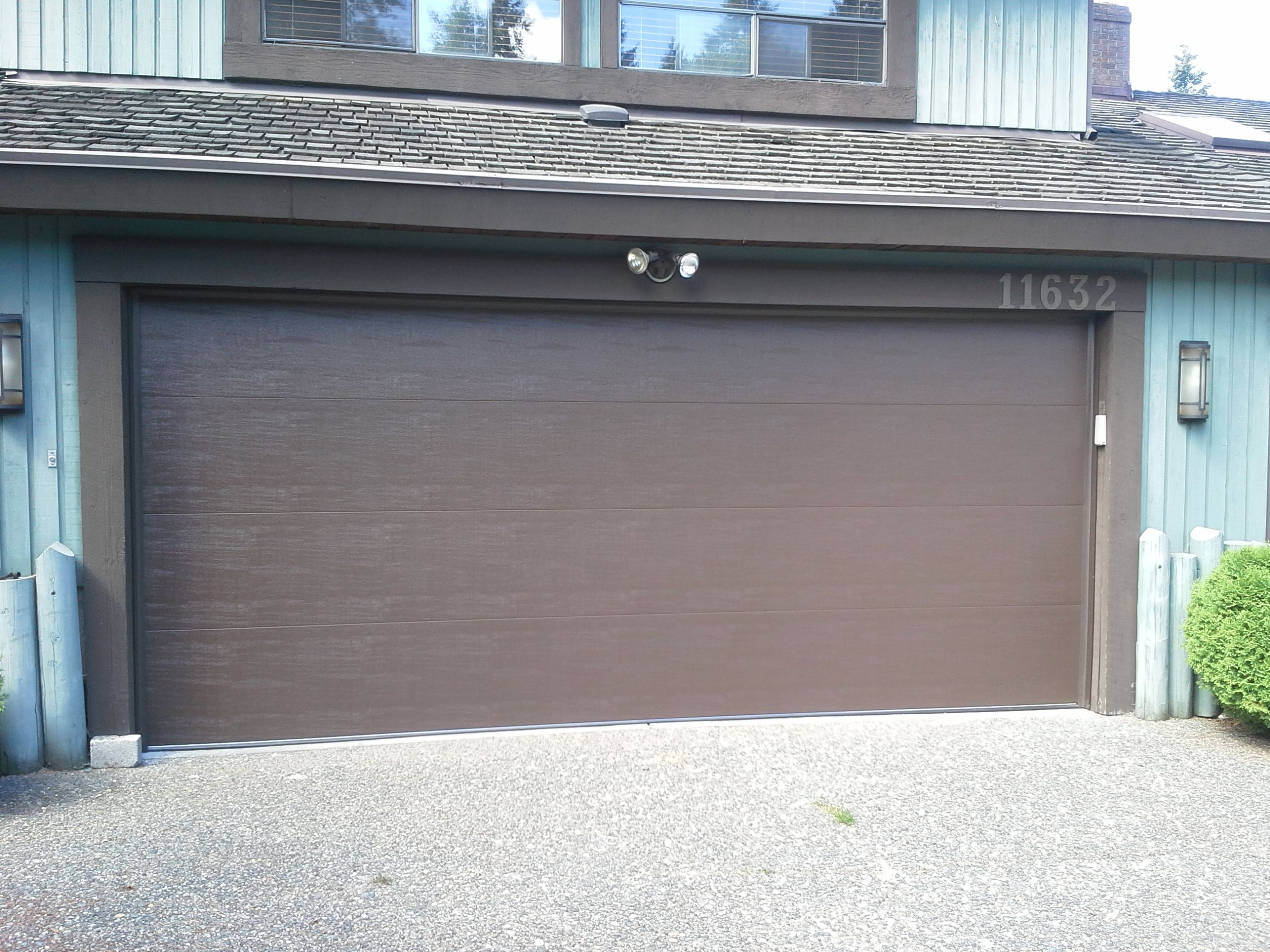 This clopay classic premium garage door in a flush panel for Flush panel wood garage door