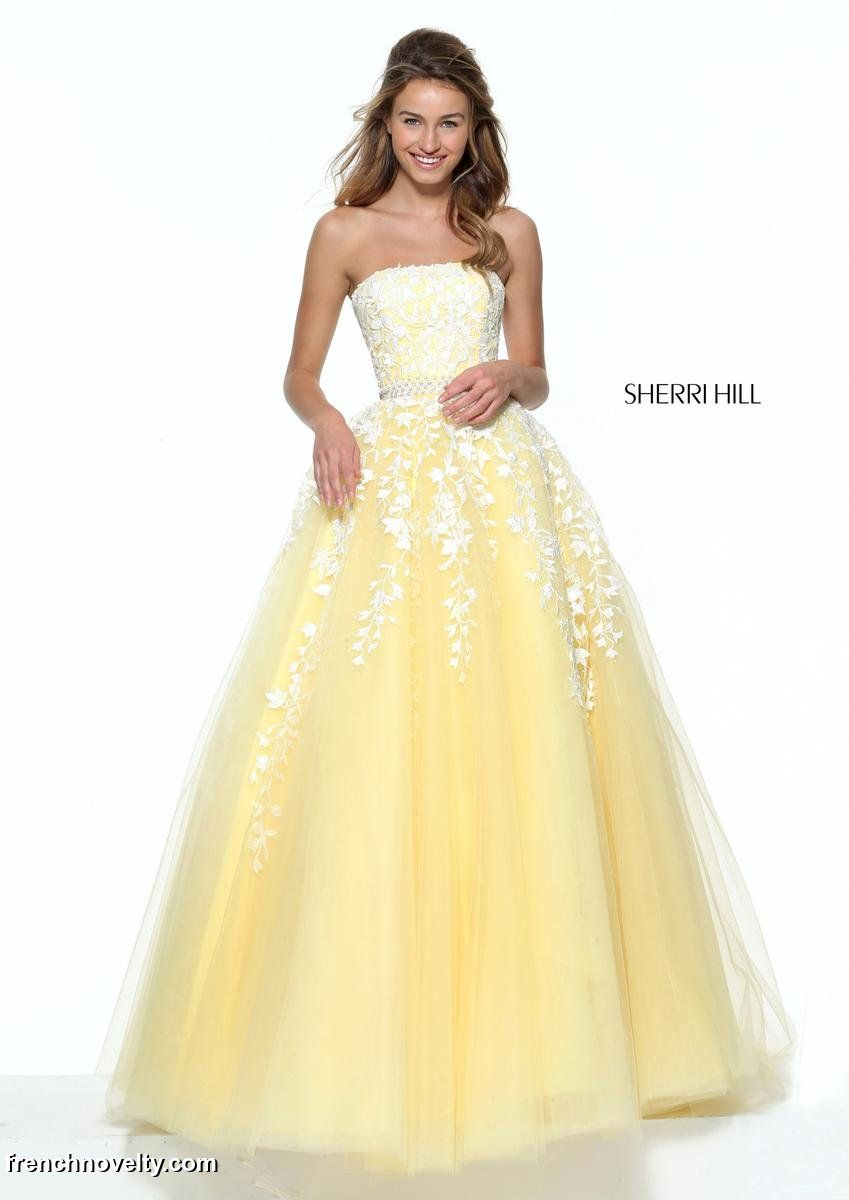 dac636cb86 Sherri Hill 50864 is a strapless ball gown with cascading floral lace  applique.