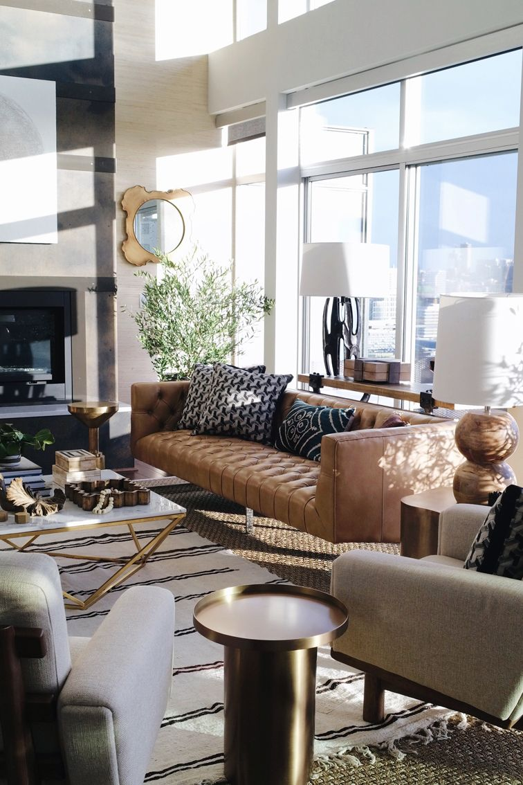 Living room Mid Century Modern inspired design  Love the layered rugs and  the leather camel. The Seattle Showhouse   Hipster blog  Mid century modern and Porch