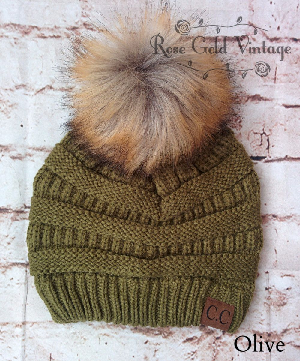 f5bf8aac125c1 A little twist on the popular CC beanie hats - a faux fur pom pom on top!  Available in 30 fabulous colors - the perfect winter accessory! 1…