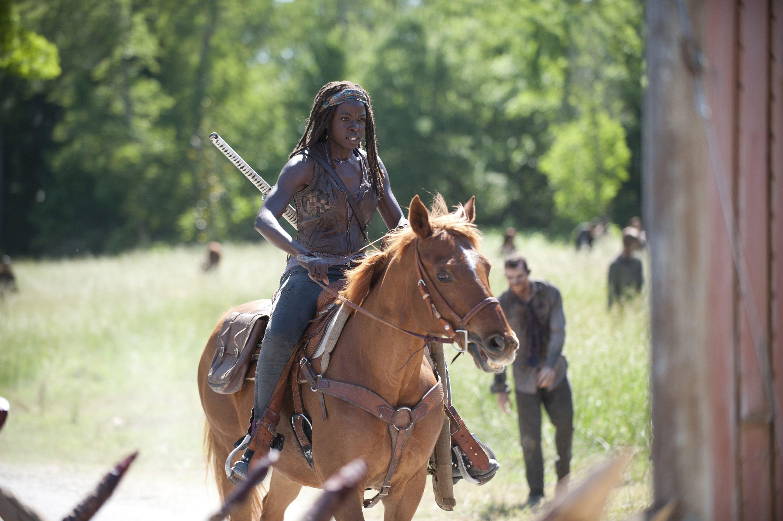 She is riding a freakin horse, boo yah!