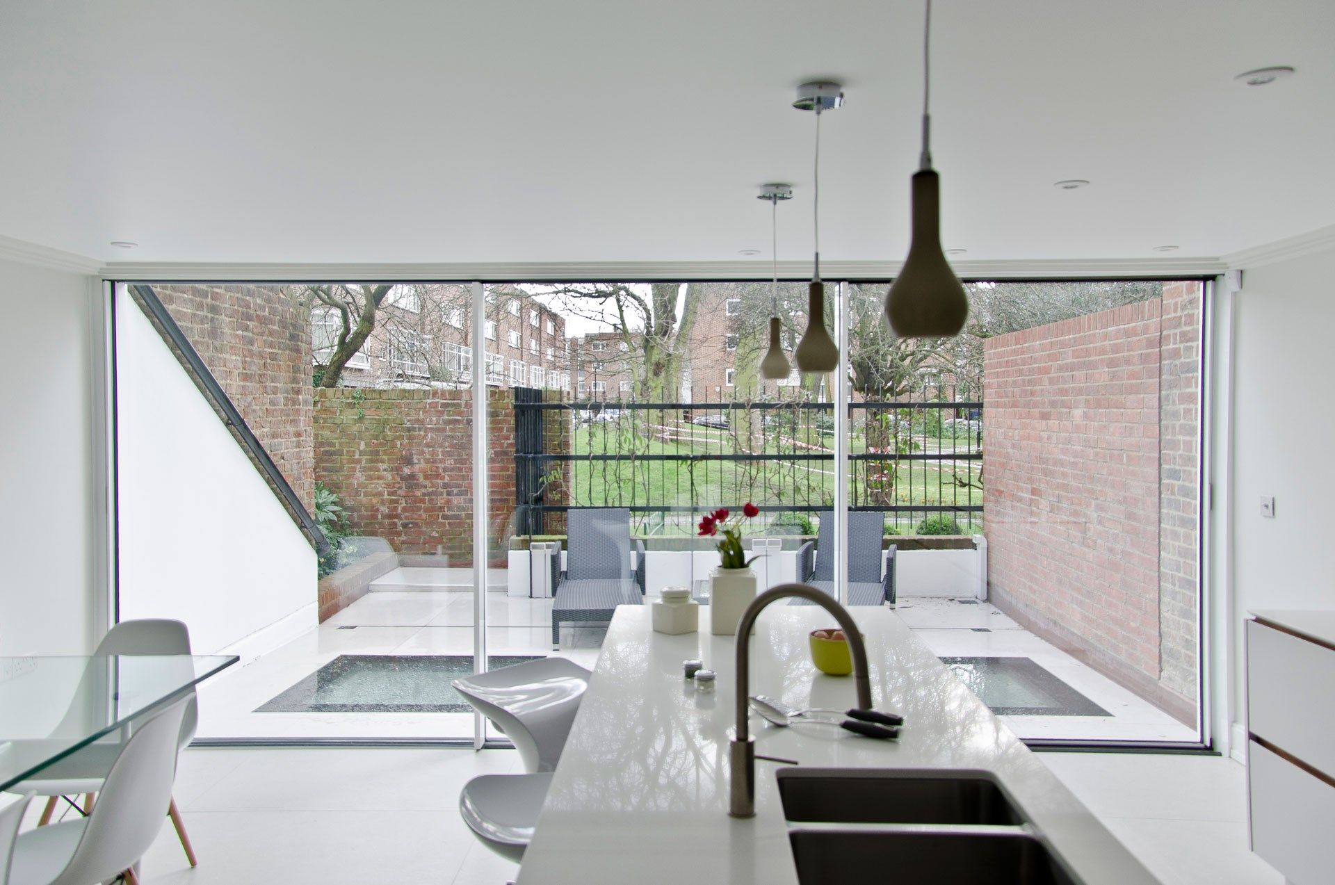 White Slim Sliding Doors And Walk On Glass Panels On The Patio In This  Sleek White