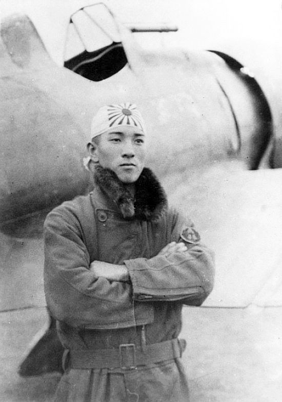 World War II A Japanese Navy pilot with his Mitsubishi A5M
