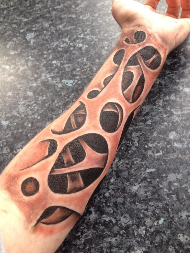 Holes and stretched skin arm body art by John Jones