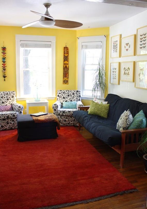 A large red rug and blue couch and ottoman are pulled - Living room color schemes red couch ...