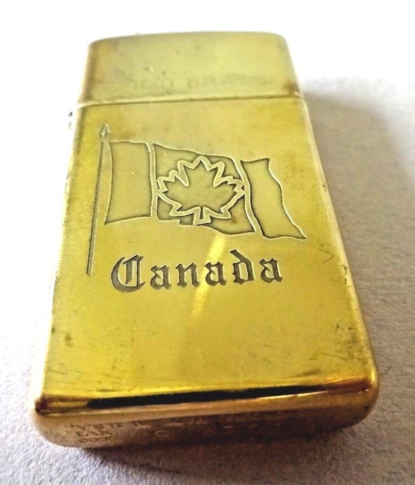 Zippo Solid Brass Slim Lighter With Embossed Canadian Flag Emblem Zippo Solid Brass Zippo Brass