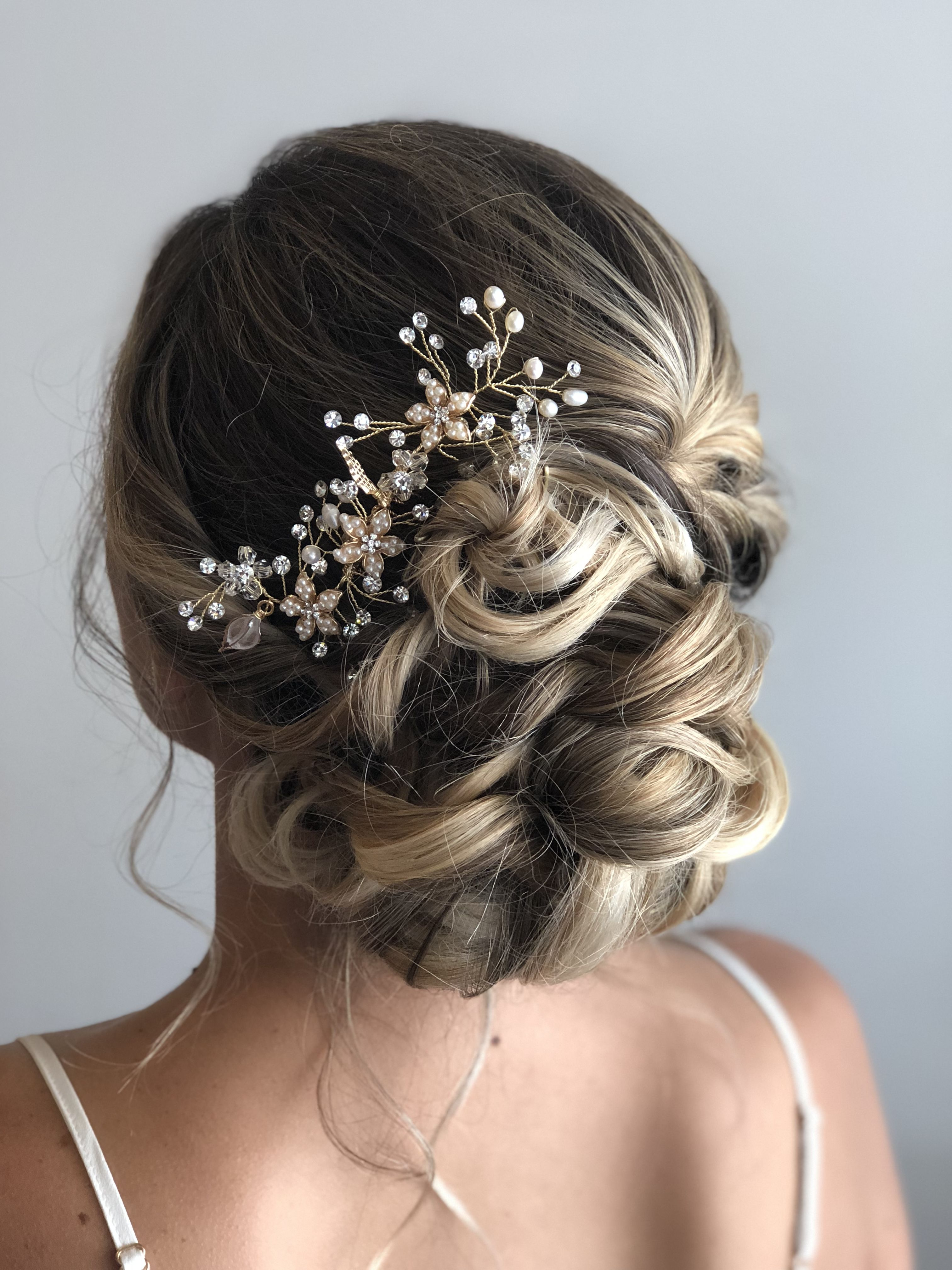 bridal updo for your wedding with volume and curl bun bridal