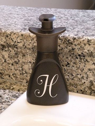 Originally a plastic, Dawn handsoap bottle.  Bronze spray paint!  So cheap and so neat!!