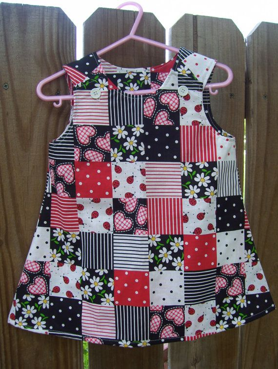 Button on the shoulder black red ladybug by RaggedyAnnieCreation,