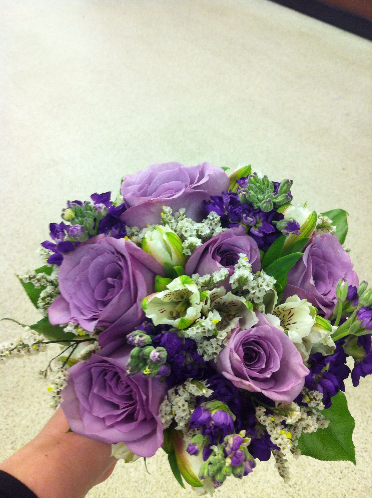Prom Nosegay With Lavender Roses Purple Stock White Alstroemeria And White Limonium Coordinatin Lavender Flower Centerpieces Homecoming Flowers Prom Flowers
