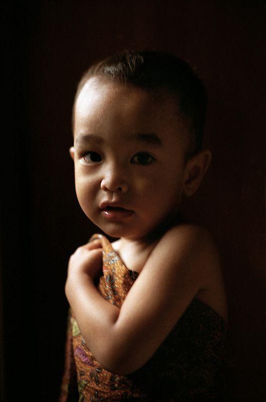 a boy in a batik fabric
