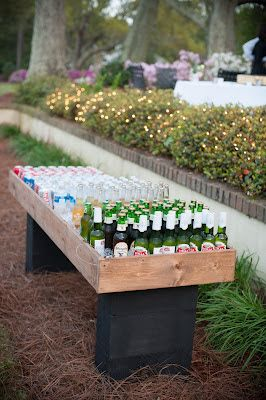 Make a cooler big enough for all the bottles and drinks. Make a big box out of wood and place it on a table or attach two legs. Fill it with ice and put in the bottles.