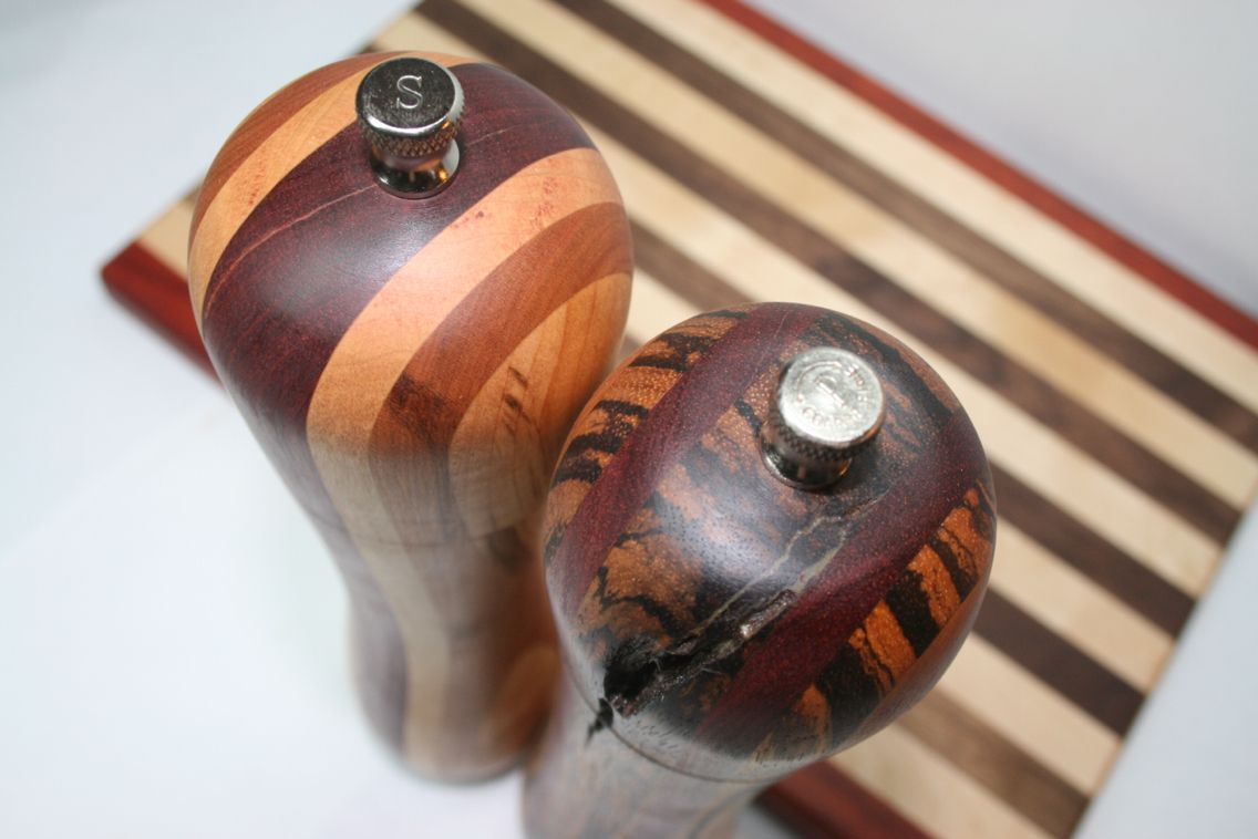 Salt and Pepper Grinders with matching Cutting Board set.